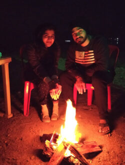 pawna lake camping for couple with warm bonfire