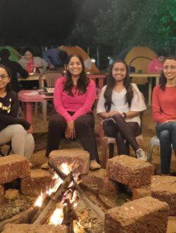 Ladies group enjoying bonfire at Pawna lake camping